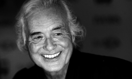 LONDON, ENGLAND - MAY 22: (EDITORS NOTE: Image has been converted to black and white.)  Jimmy Page poses in the winners room at The Ivor Novello Awards at The Grosvenor House Hotel on May 21, 2014 in London, England.  (Photo by Dave J Hogan/Getty Images)